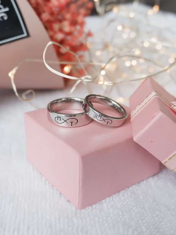 infinity with name engraved rings